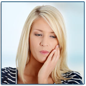 woman holding her jaw in need of an emergency dentist